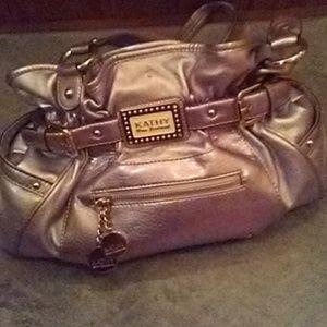Kathy Van Zeeland handbag with charms.